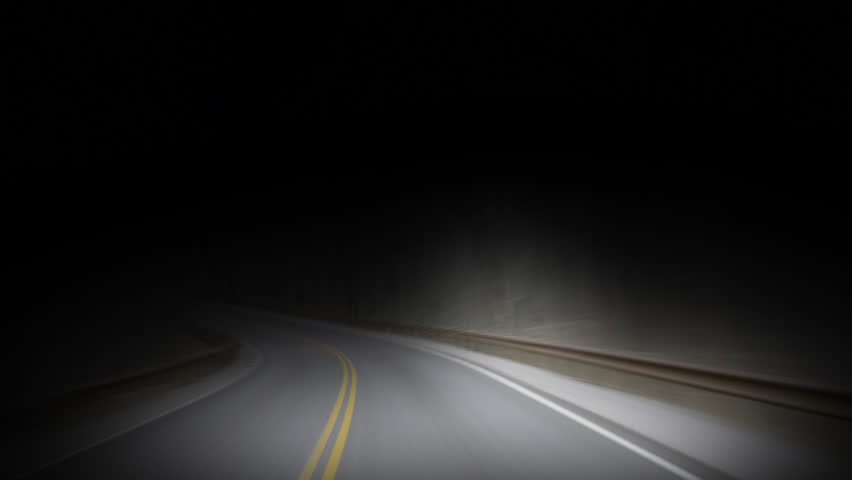 car on dark road